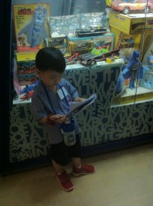 El reading his workbook intently