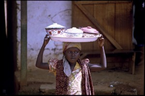 african child carrying water