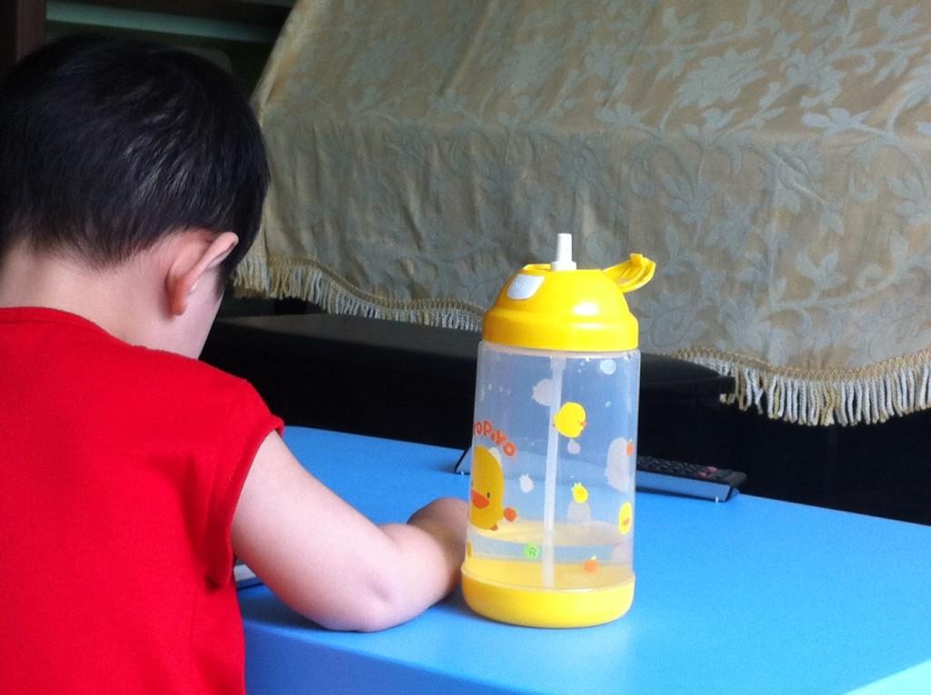 yellow piyo piyo water bottle