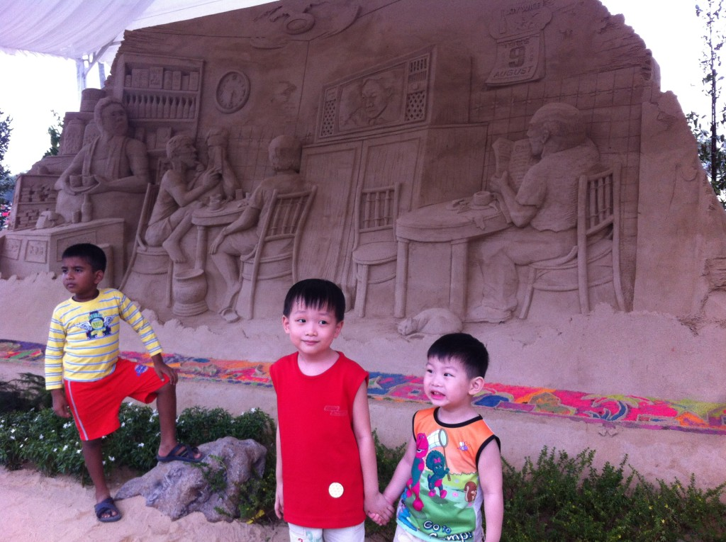 children at a coffeeshop sandcastle