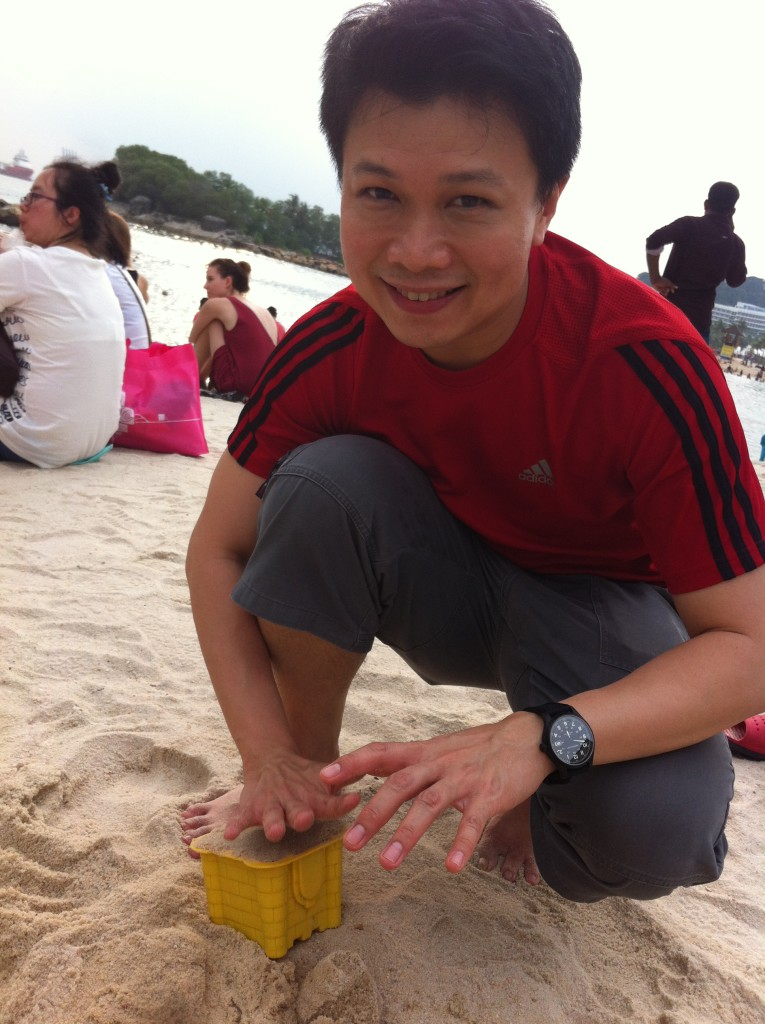 father building sandcastle