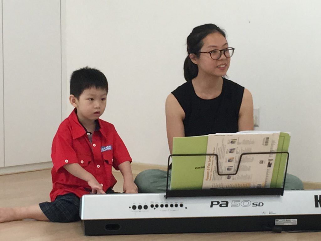 exploring the keyboard with the teacher